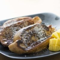 Gabor's french toast plated with mango on the side