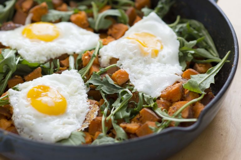 sweet potato hash server with eggs on top