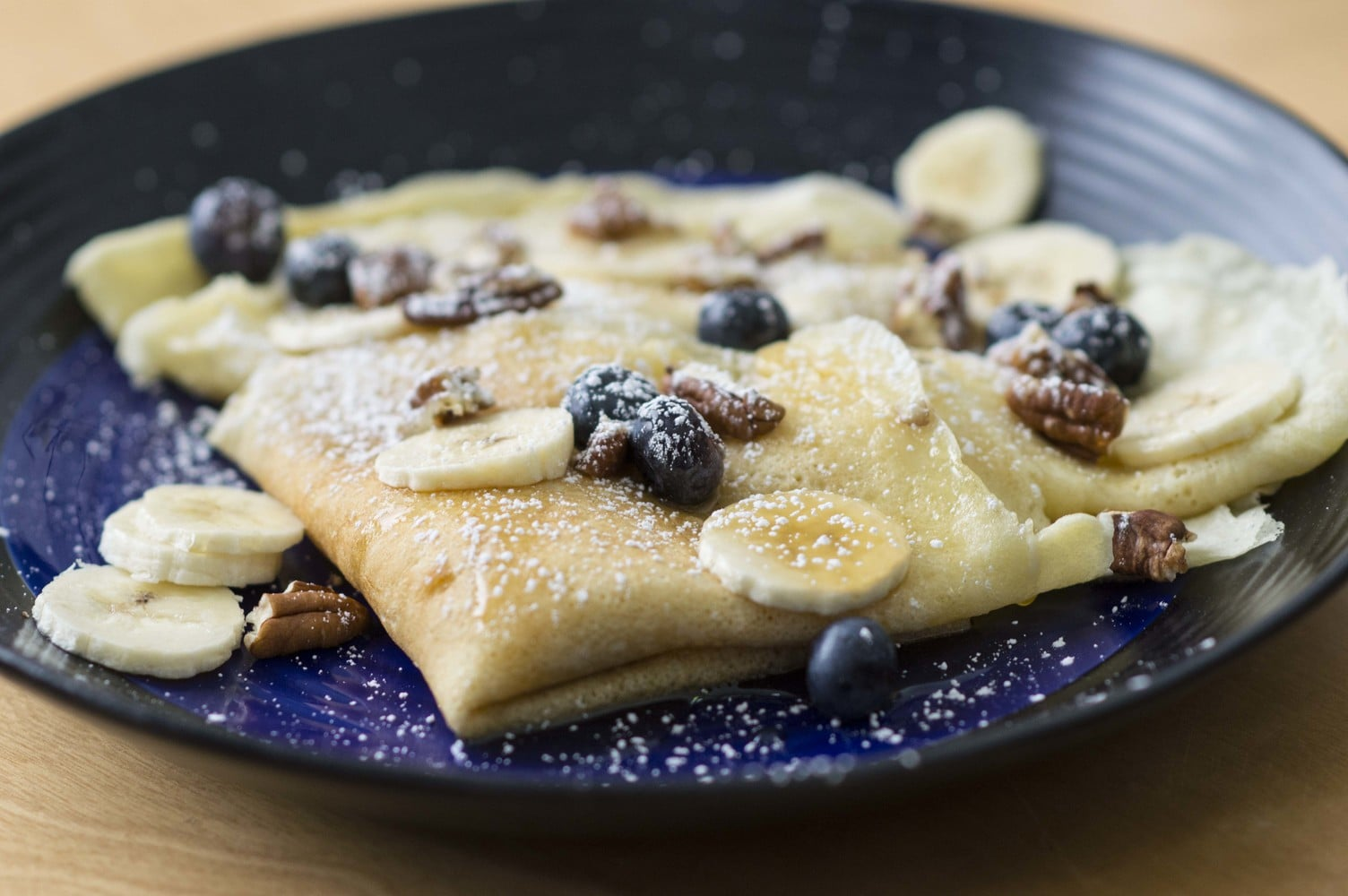 blueberry ricotta crepes plated and ready to eat