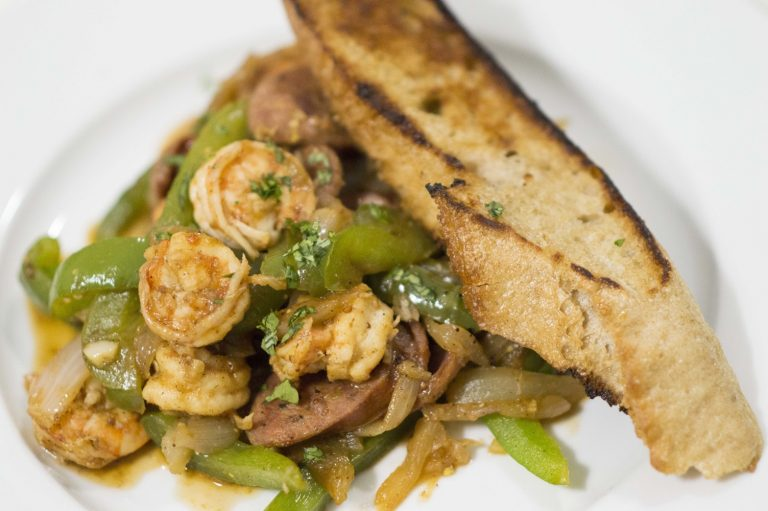 The Sausage, Peppers, Onions & Shrimp dish plated and served