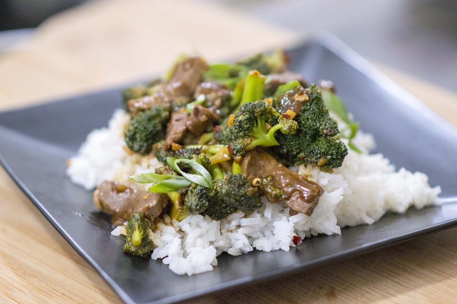 Beef and Broccoli served over rice with green onion